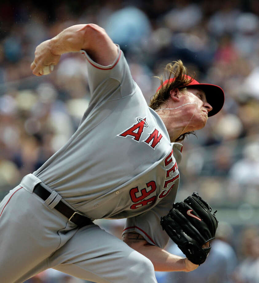 Los Angeles Angels starting pitcher Jered Weaver delivers in the first inning against the New York Yankees during their baseball game at Yankee Stadium in New York, Sunday, July 15, 2012. (AP Photo/Kathy Willens) / AP