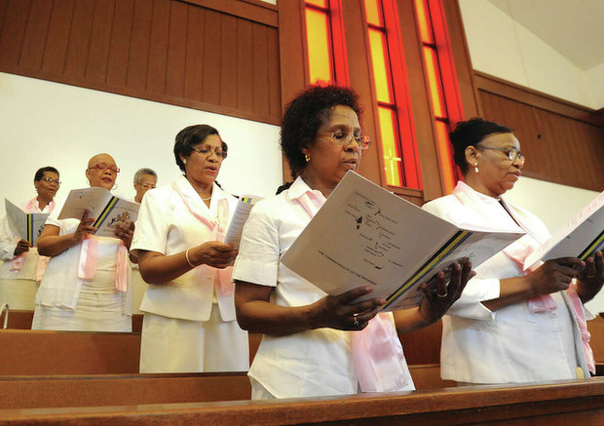 Hour photo / Matthew Vinci The Calvary Baptist Church Choir sings the processional hymn Sunday at the celebration of the 39th anniversary of independence in the Bahamas.
