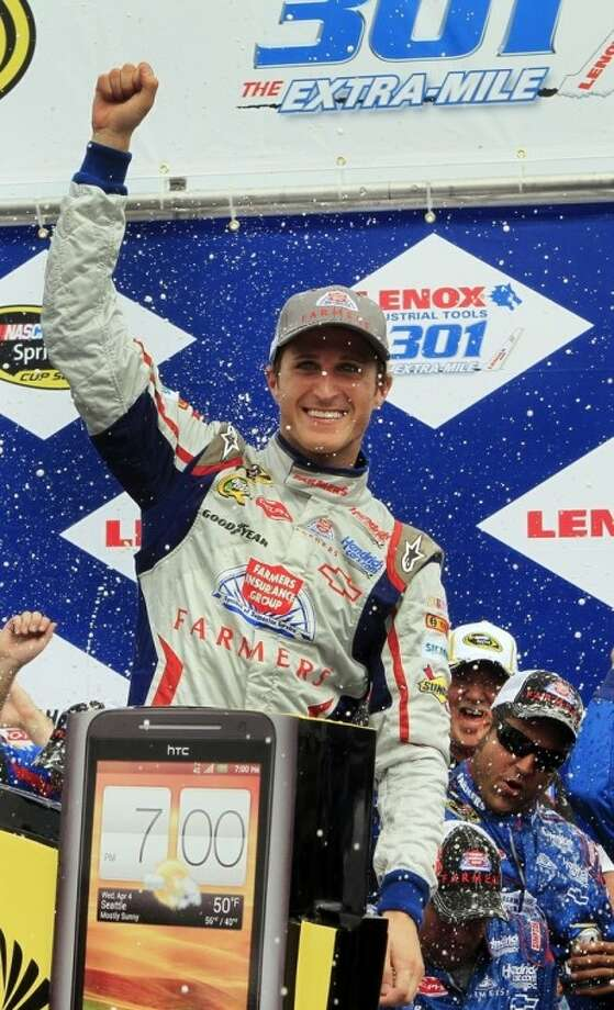 Kasey Kahne celebrates in victory lane after winning the NASCAR Sprint Cup Series auto race, Sunday July 15, 2012 at New Hampshire Motor Speedway in Loudon, N.H. (AP Photo/Jim Cole)