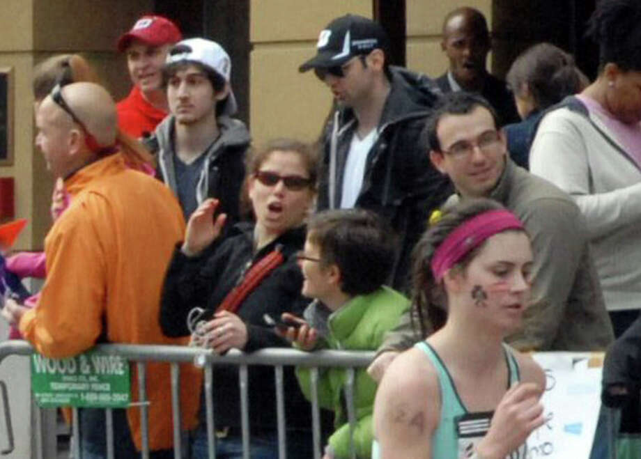 This Monday, April 15, 2013 photo provided by Bob Leonard shows third from left, Tamerlan Tsarnaev, who was dubbed Suspect No. 1 and second from left, Dzhokhar A. Tsarnaev, who was dubbed Suspect No. 2 in the Boston Marathon bombings by law enforcement. This image was taken approximately 10-20 minutes before the blast. (AP Photo/Bob Leonard) / Courtesy of Bob Leonard