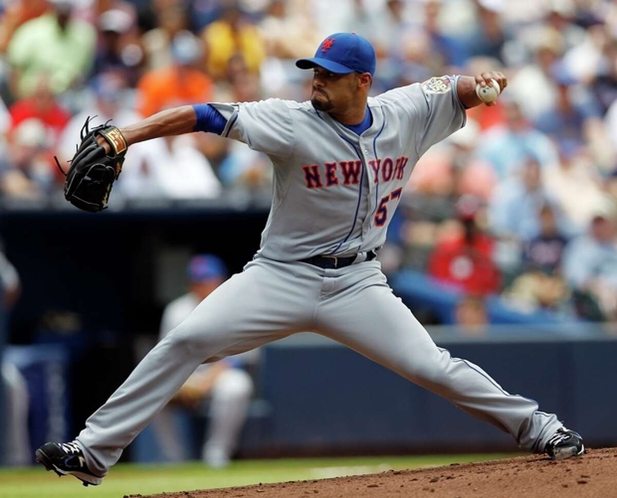 New York Mets starting pitcher Johan Santana works in the first inning of a baseball game against the Atlanta Braves, Sunday, July 15, 2012, in Atlanta. (AP Photo/John Bazemore)