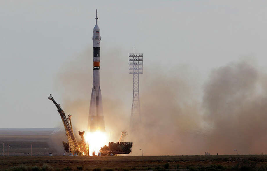 AP Photo/Dmitry LovetskyThe Soyuz-FG rocket booster with Soyuz TMA-05M blasts off from the Russian leased Baikonur cosmodrome, Kazakhstan, Sunday. / AP