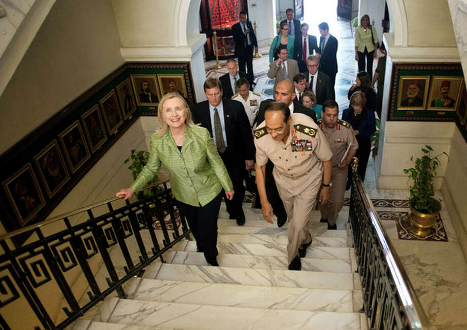 Field Marshal Hussein Tantawi walks with US Secretary of State Hillary Rodham Clinton to a meeting at the Ministry of Defense July 15, 2012 in Cairo, Egypt. Clinton was holding talks with Egypt's top military leaders, just hours after calling for them to help smooth the country's full transition to democracy. (AP Photo/Brendan Smialowski, Pool) / AFP Pool