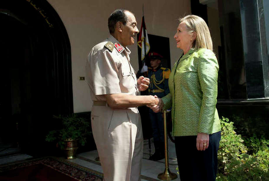 Field Marshal Hussein Tantawi, left, greets US Secretary of State Hillary Rodham Clinton before a meeting at the Ministry of Defense July 15, 2012 in Cairo, Egypt. Clinton is holding talks with Egypt's top military leaders to press for the military to work with Egypt's new Islamist leaders on a full transition to civilian rule. (AP Photo/Brendan Smialowski, Pool) / AFP Pool