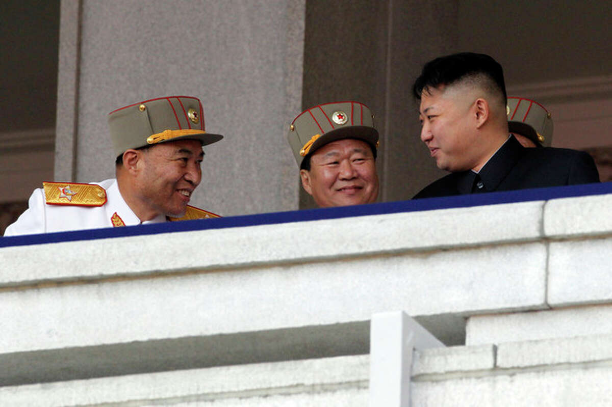 In this photo taken Sunday, April 15, 2012, North Korean leader Kim Jong Un, right, looks over at North Korean People's Army senior officers, Vice Marshal and Vice Chairman of the Central Military Commission Choe Ryong Hae, center, and Vice Marshal and the military's General Staff Chief Ri Yong Ho, left, during a mass military parade in Kim Il Sung Square to celebrate the centenary of the birth of his grandfather, national founder Kim Il Sung in Pyongyang, North Korea. North Korea said Monday, July 16, 2012 it has relieved Ri Yong Ho from all posts because of illness. (AP Photo/Ng Han Guan)
