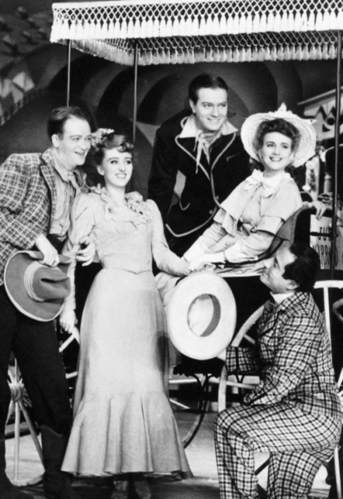 """FILE - In a 1943 file photo, from left, Lee Dixon, Celeste Holm, Alfred Drake, Joan Roberts and Joseph Buloff are seen in the original production of """"Oklahoma!"""" Holm, who soared to Broadway fame in """"Oklahoma!"""" died Sunday July 15, 2012, a relative said. She was 95. (AP Photo)"""