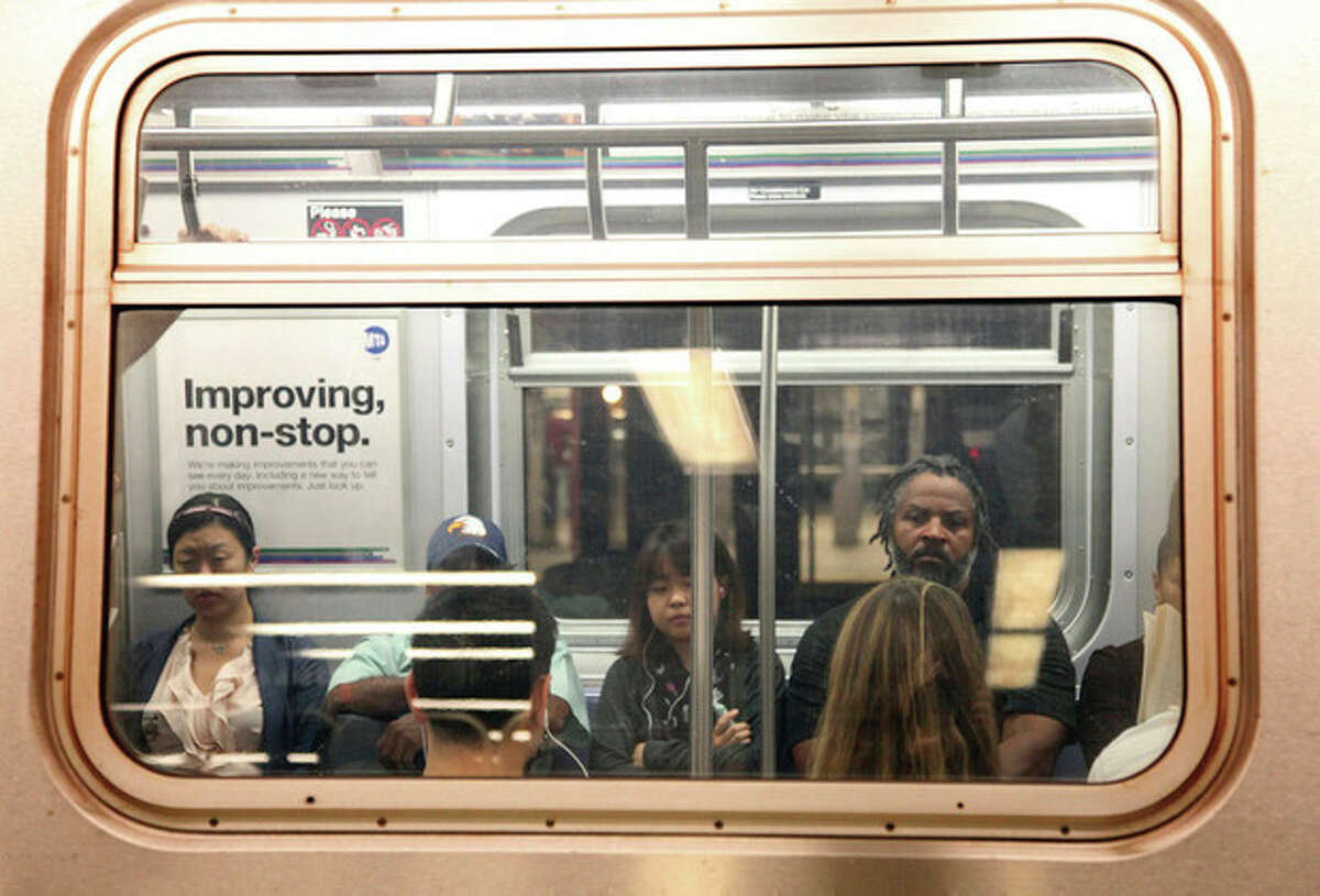People ride the subway Monday morning, Aug. 29, 2011, in New York. New York City's transit system is easing back to life after being shut down in advance of Tropical Storm Irene. (AP Photo/Chelsea Matiash)