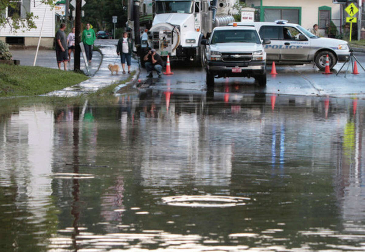 Water covers Main Street in the aftermath of Tropical Storm Irene on Monday, Aug. 29, 2011, in Waterbury, Vt. (AP Photo/Toby Talbot)