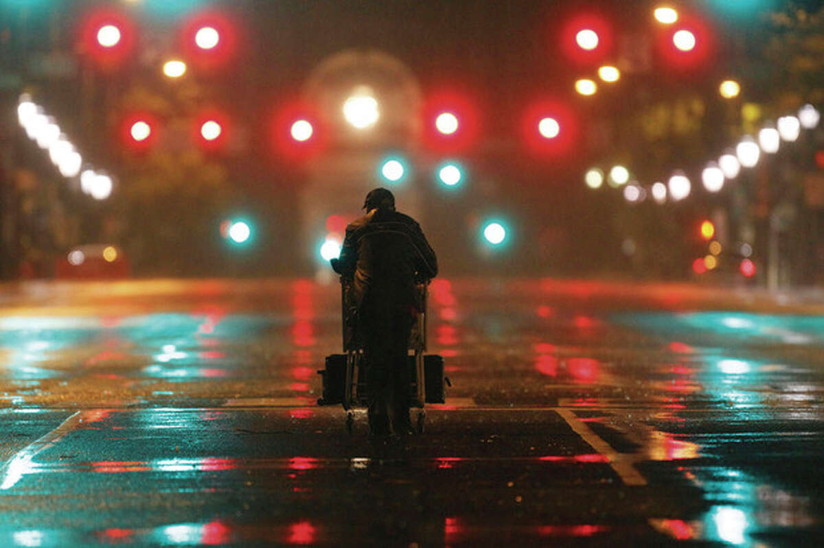 Lenard Sanders, a homeless man, pushes his cart toward a subway station to seek shelter as Hurricane Irene makes its way along the Eastern Seaboard, Sunday, Aug. 28, 2011, in Philadelphia. The National Hurricane Center says a hurricane warning remains in effect from coastal Virginia northward to Sagamore Beach, Mass. The storm remained a Category 1 hurricane and forecasters expect little change in strength before an expected landfall later Sunday. (AP Photo/Matt Rourke)
