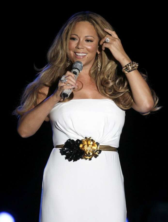 """FILE - This June 2, 2012 file photo shows American singer Mariah Carey performing during a concert in Monaco. A person familiar with the singing competition series """"American Idol"""" negotiations say Carey is being pursued to join the judging panel of the Fox talent competition. The source requested anonymity because of the private nature of negotiations. (AP Photo/Lionel Cironneau, file)"""