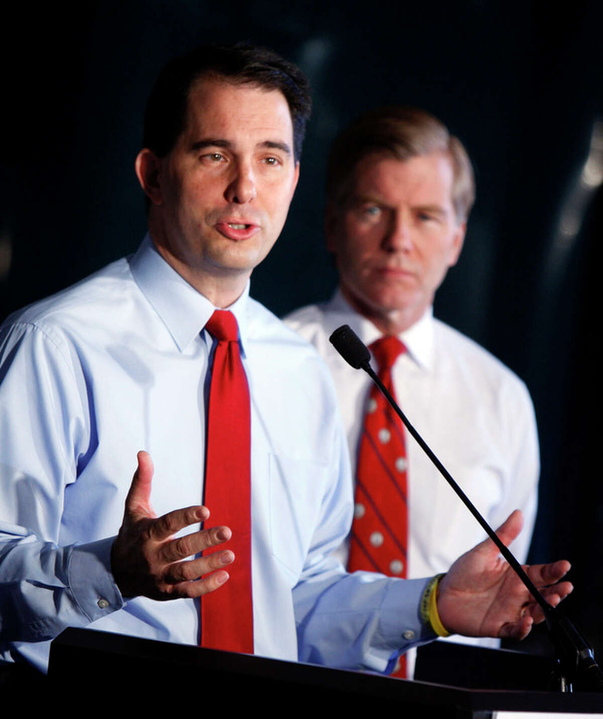 Wisconsin Gov. Scott Walker, left, and Virginia Gov. Bob McDonnell, right, during a news conference at Copland Trucking in Williamsburg, Va., Friday, July 13, 2012. before the start of the National Governors Association meeting. McDonnell and Walker are two of the governors attending the National Governors Association meeting in Williamsburg. (AP Photo/Richmond Times-Dispatch, Bob Brown)