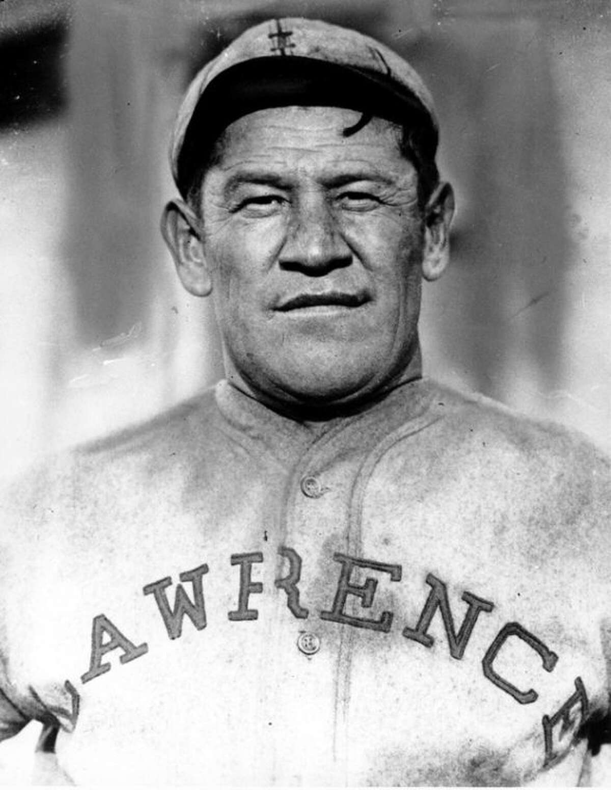 FILE - In this undated file photo, Jim Thorpe poses in a baseball uniform. The two surviving children of sports great Thorpe won a critical ruling on Friday, April 19, 2013, in federal court that could clear the way for his remains to be removed from a mausoleum in the Pennsylvania town that bears his name and reinterred on American Indian land in Oklahoma. (AP Photo/File)