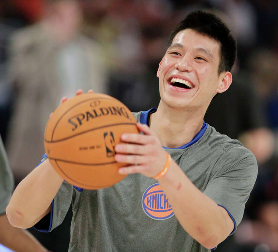 FILE - This Feb. 24, 2012 file photo shows New York Knicks' Jeremy Lin laughing during warmups before the start of the NBA All-Star Rising Stars Challenge basketball game in Orlando, Fla. This would have been such an easy decision in February. Lin was the biggest thing in basketball, and no way the Knicks would have let him go elsewhere. Now, knowing his price and with no assurance he'll play as he did when Linsanity reigned, the Knicks may allow Lin to leave for Houston. (AP Photo/Chris O'Meara, File) / AP