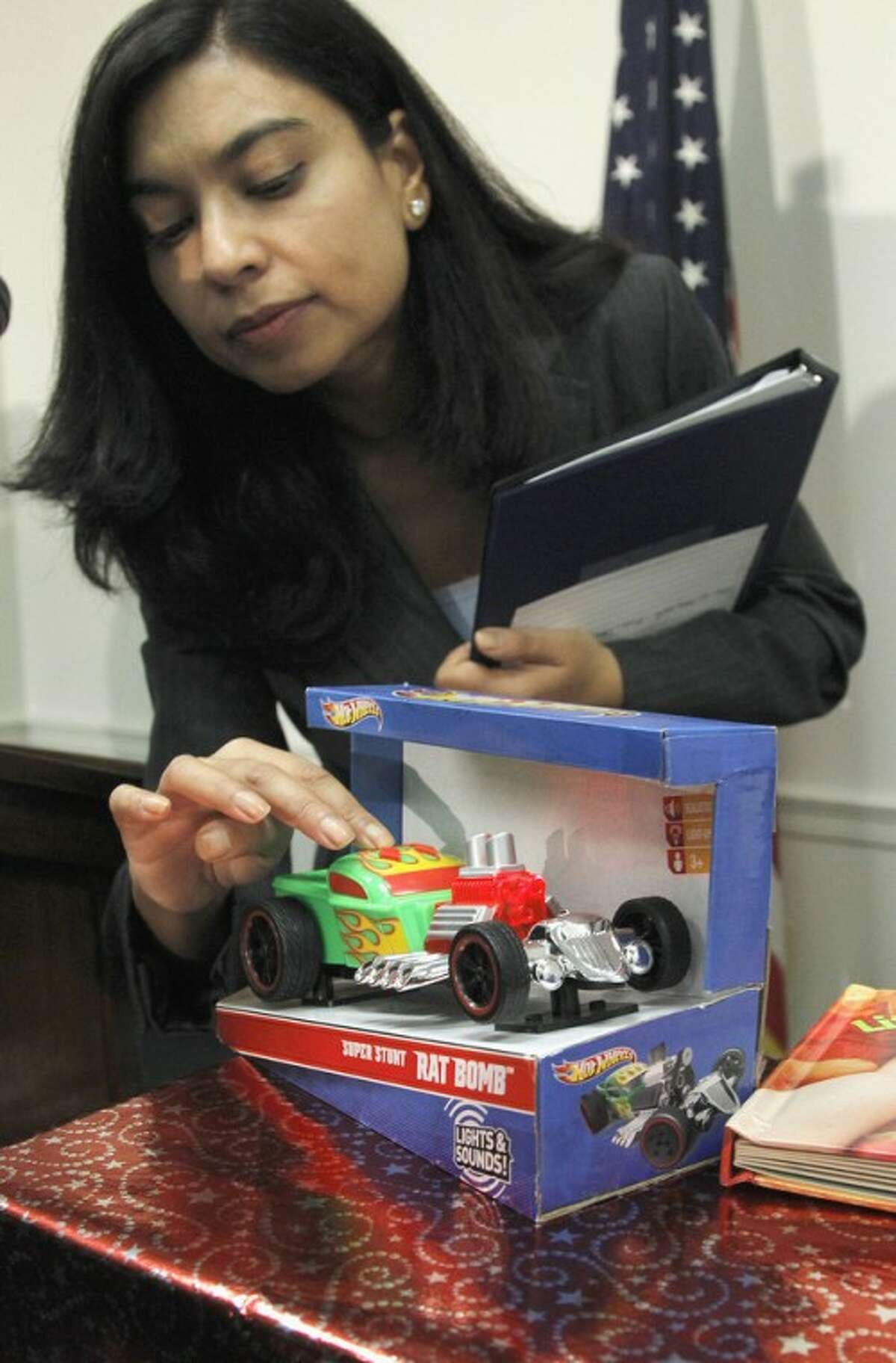 Nasima Hossain from the US Public Interest Research Group (PIRG) demonstrates a toy that has high noise levels during their news conference on dangerous or toxic toys, Tuesday, Nov. 22, 2011, on Capitol Hill in Washington. (AP Photo/Pablo Martinez Monsivais)