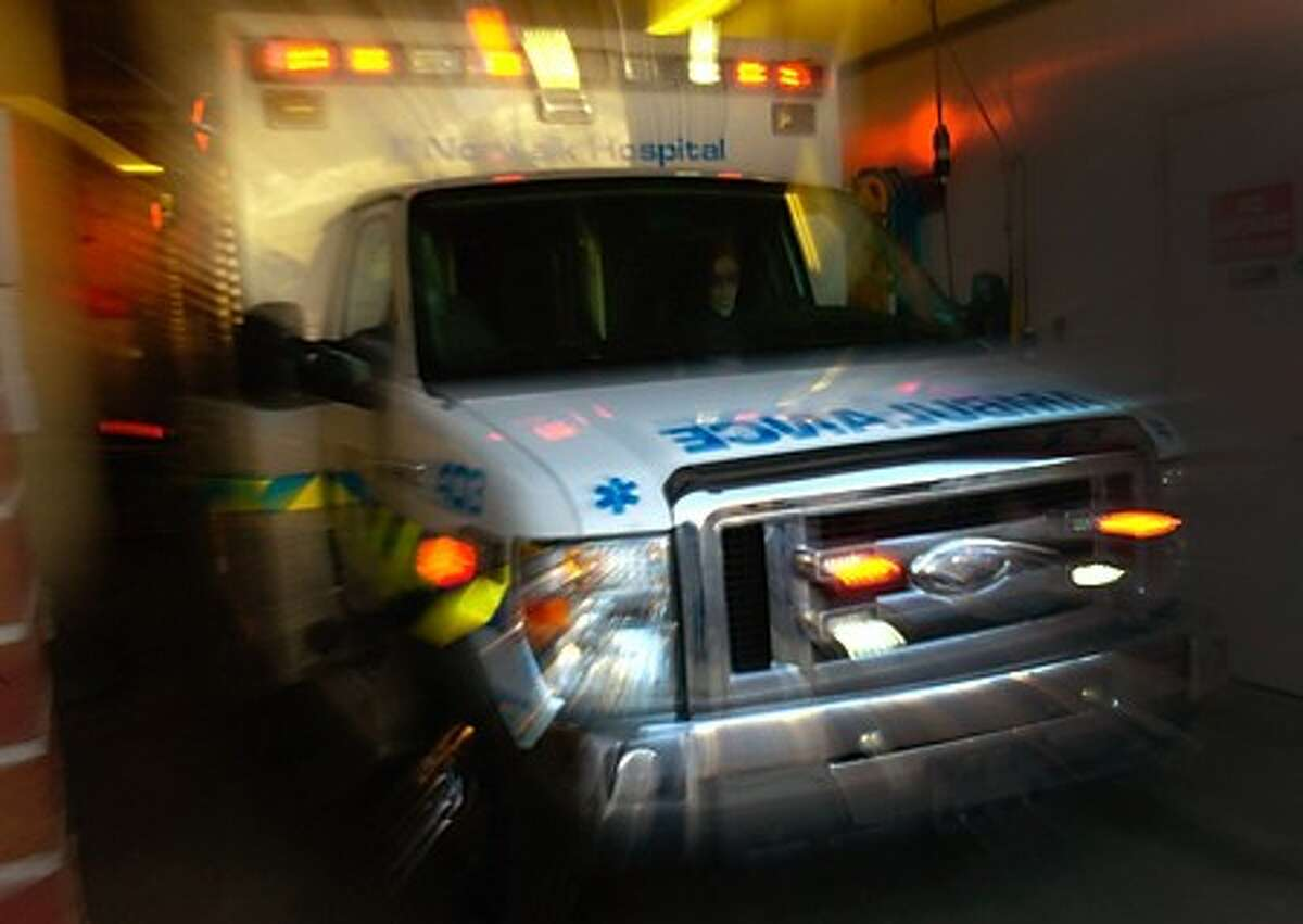 Norwalk Hospital paramedics get ready to leave on a call from the hospital''s EMT headquarters. Hour photo / Erik Trautmann