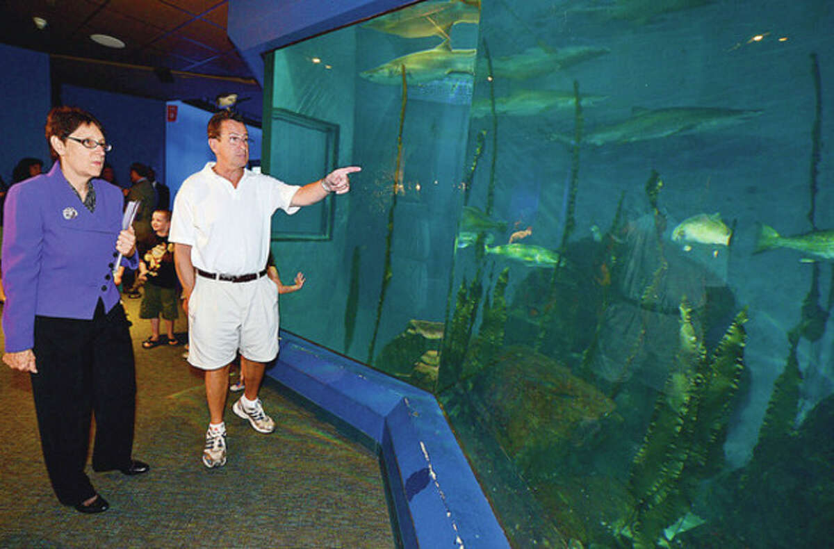 Hour photos / Erik Trautmann Above and below, Gov. Dannel Malloy tours the Maritime Aquarium with aquarium President and CEO Jennifer Herring on Tuesday.