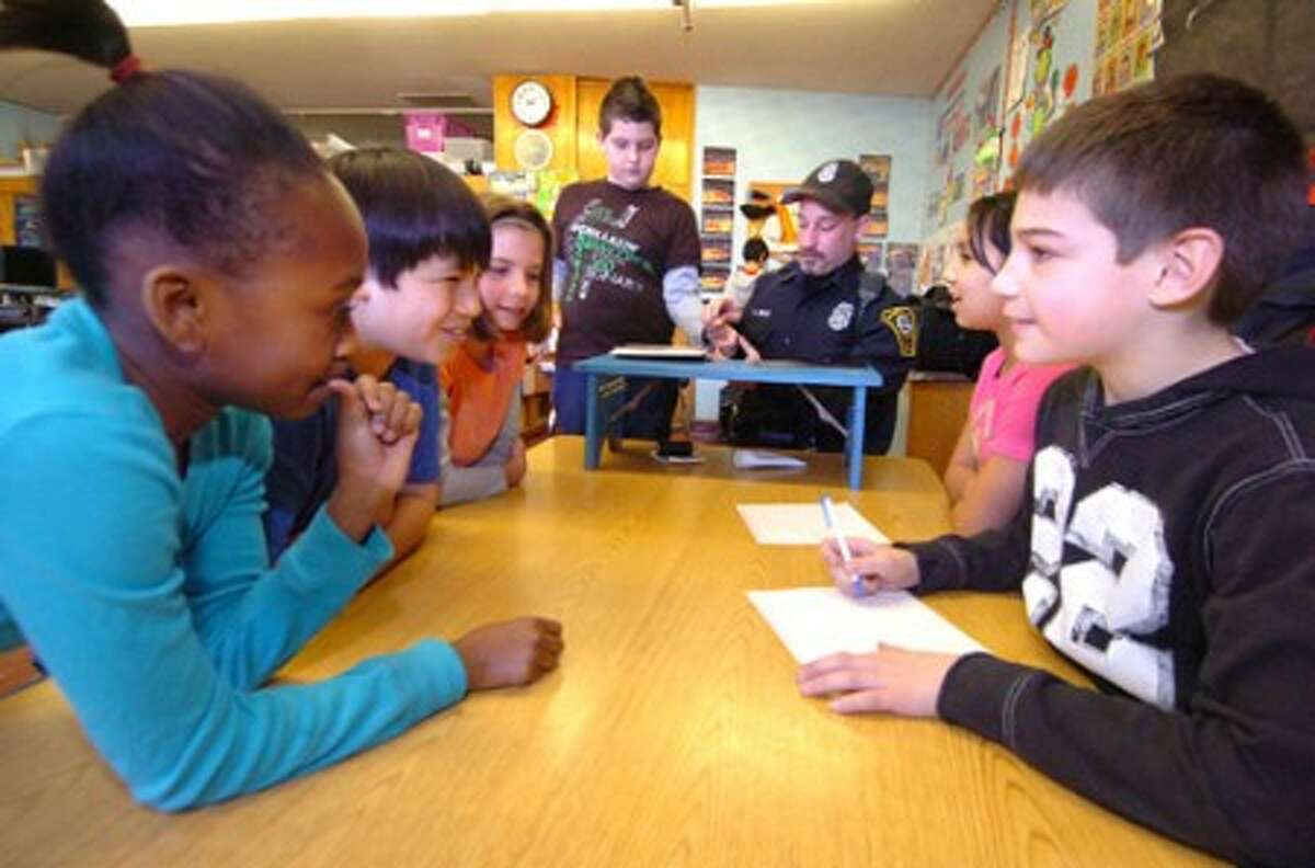 Photo/Alex von Kleydorff. 5th graders in Janine Lane''s 5th grade class take part in the ''Back to your Future. Careers'', part of the Family Resource Center''s positive Youth development program at Fox Run school