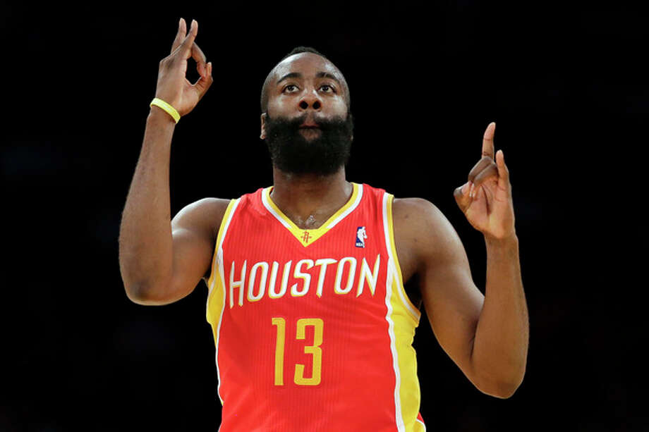 Houston Rockets' James Harden reacts after making a 3-pointer during the first half of an NBA basketball game against the Los Angeles Lakers in Los Angeles, Wednesday, April 17, 2013. (AP Photo/Jae C. Hong) / AP