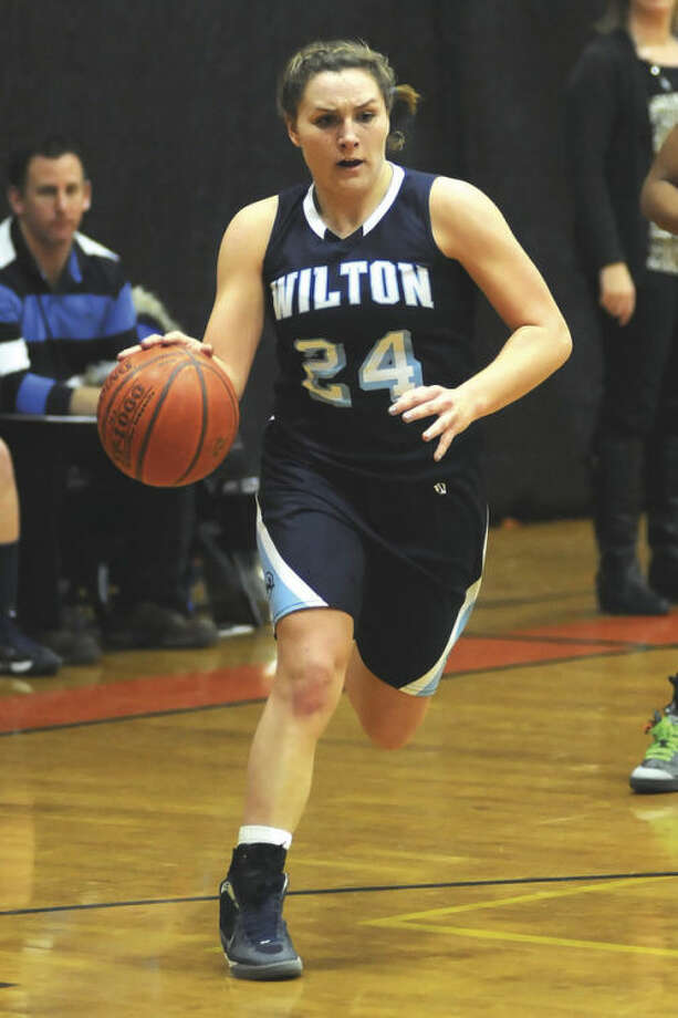 Hour photo/John NashWilton's Casey Pearsall brings the ball downcourt during one of the Warriors' games this past season. If there was ever any doubt about the 5-foot-8 senior's value to her team, the point was driven home when an injury forced the All-Area MVP to the sidelines for Wilton's final contest.