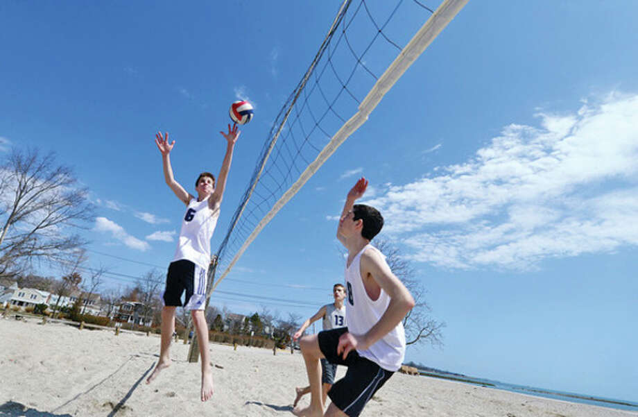 Staples High School Junior Varsity volleyball players Jonas Piekara, Quinn Hughes and Jared Himmel get some practice in at Compo Beach in Westport Tuesday during their school's Spring Break.Hour photo / Erik Trautmann / AP
