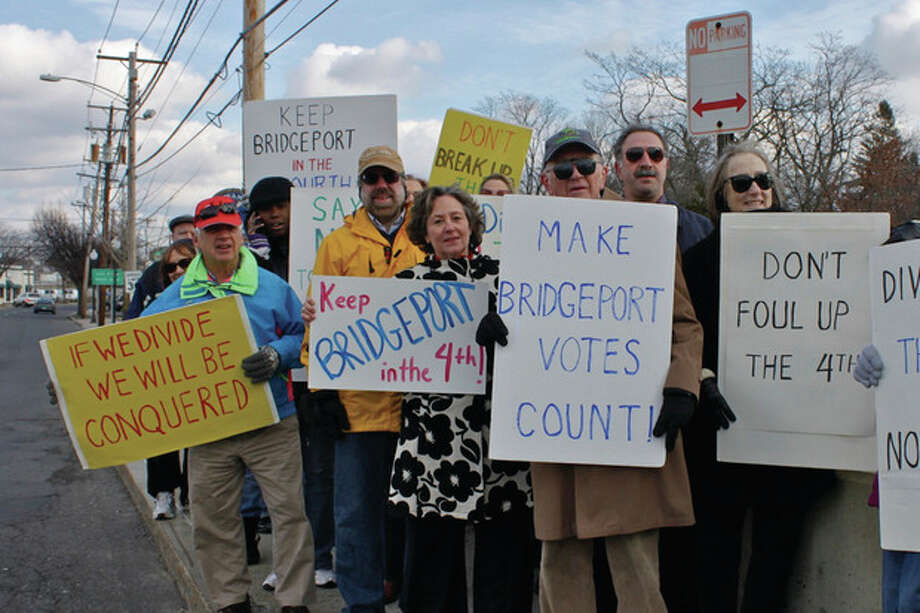 "Contributed photo Area activists line the bridge on Route 130 between Fairfield and the Black Rock area in Bridgeport on Saturday. From left: Scott Kimmich, Norwalk (blue coat); Doug Sutherland, Trumbull (yellow coat); Mary-Jane Foster, Bridgeport; Bill Collins, Norwalk (peering over ""Make Bridgeport Count"" sign); State Rep. Jonathan Steinberg, Westport (also peering over ""Make Bridgeport Count"" sign), and MoveOn Regional Coordinator Terry Masters, Stratford."