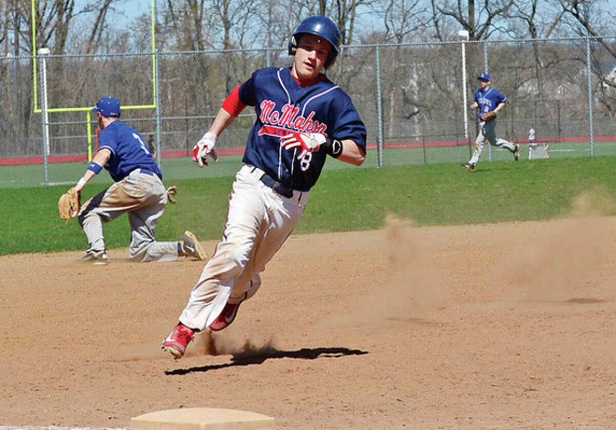 Hour photo/Erik Trautmann Brien McMahon's Sawyer Machette rounds third as he heads to the plate to score one of the Senators' runs in a sixth inning rally. The rally fell short, and McMahon dropped a 6-3 decision Wednesday to visiting Ludlowe.