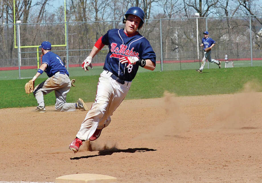 Hour photo/Erik TrautmannBrien McMahon's Sawyer Machette rounds third as he heads to the plate to score one of the Senators' runs in a sixth inning rally. The rally fell short, and McMahon dropped a 6-3 decision Wednesday to visiting Ludlowe.