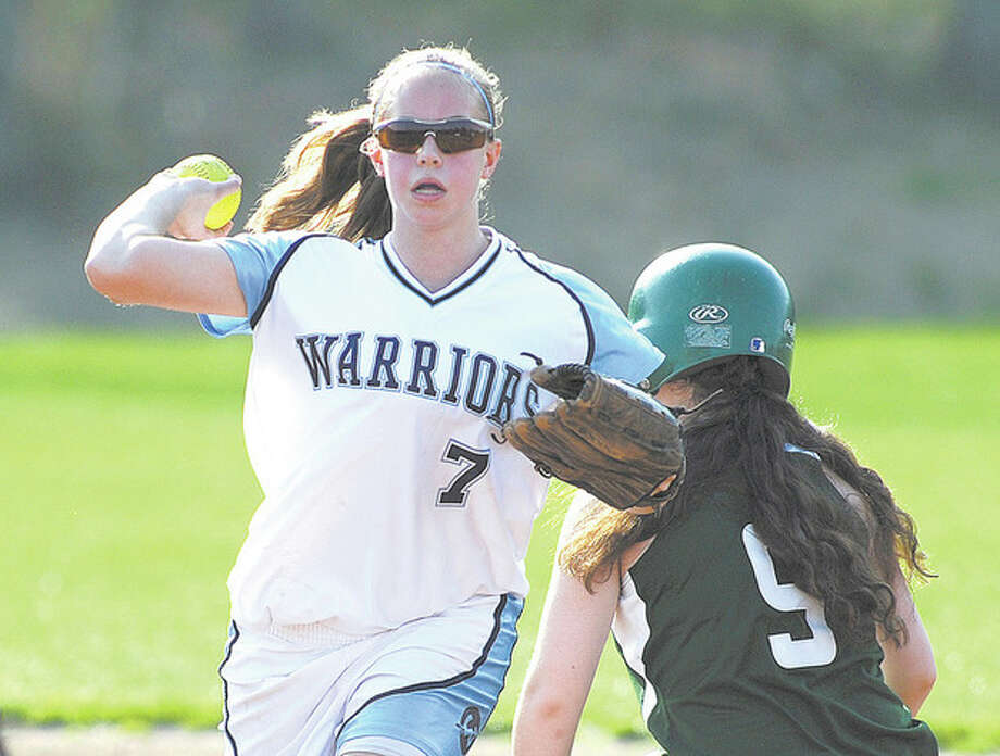 Hour Photo/John Nash - Wilton SS Amy Salvato fires to first after forcing out Norwalk's Patti Sciglimpaglia at second base on a fielder's choice.