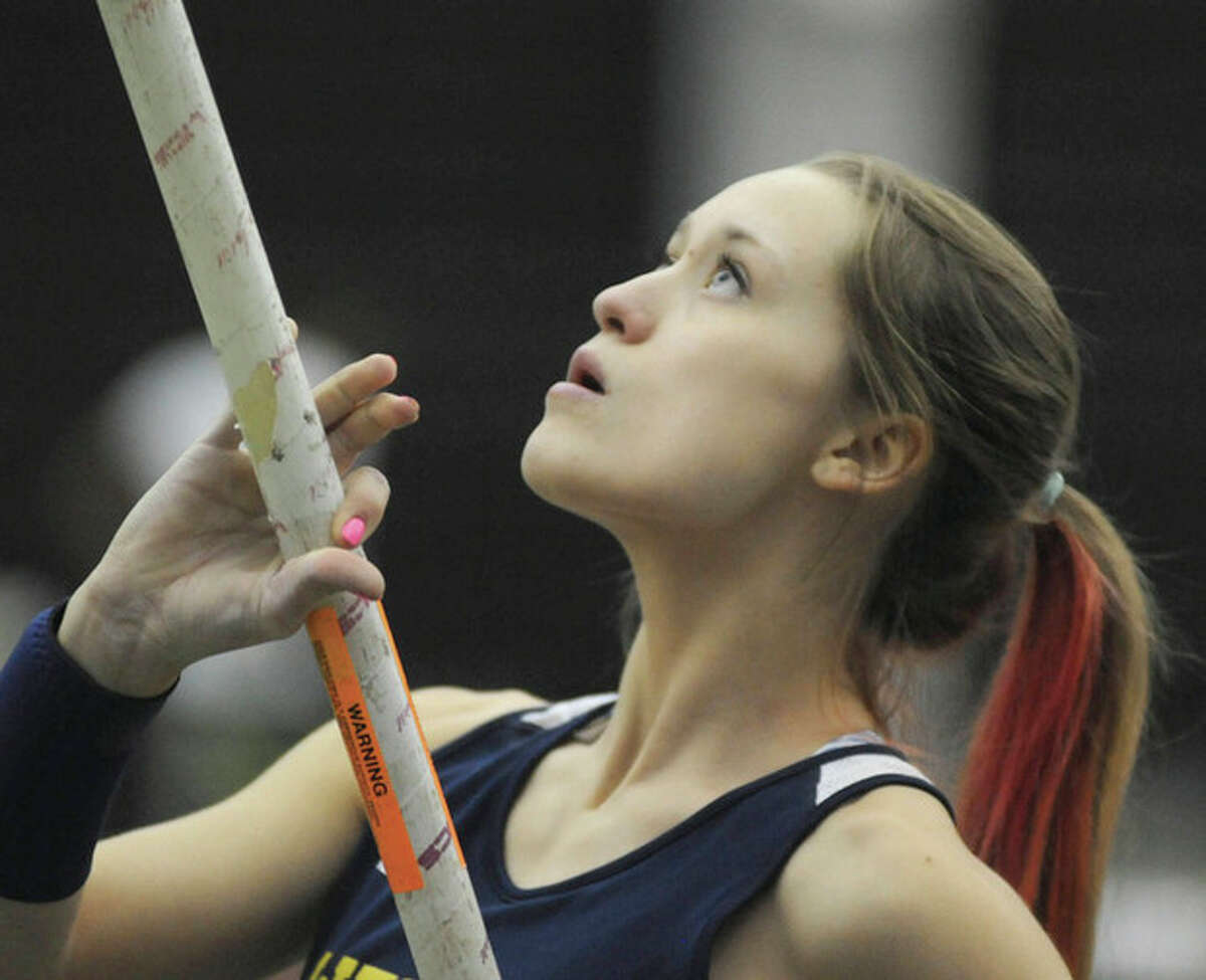 Hour photo/John Nash Emily Savage, Weston's record-setting pole vaulter, prepares for a vault during a meet this winter. The senior has been selected as the MVP of The Hour's All-Area girls indoor track team.