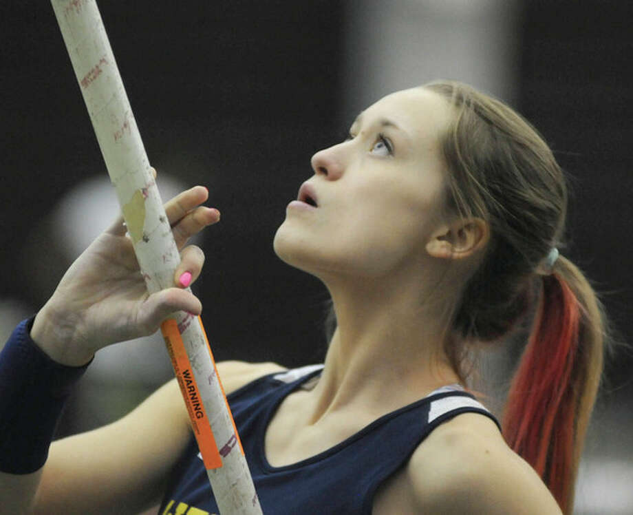 Hour photo/John NashEmily Savage, Weston's record-setting pole vaulter, prepares for a vault during a meet this winter. The senior has been selected as the MVP of The Hour's All-Area girls indoor track team.