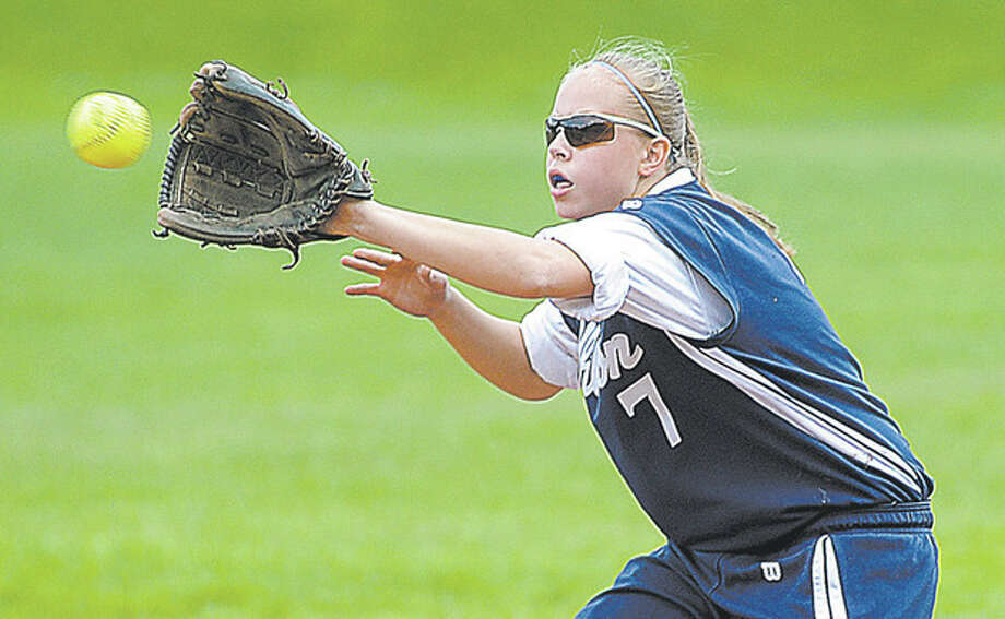 Hour Photo/John Nash - Wilton SS Amy Salvato waits to grab a throw from her catcher on a successful stolen base.