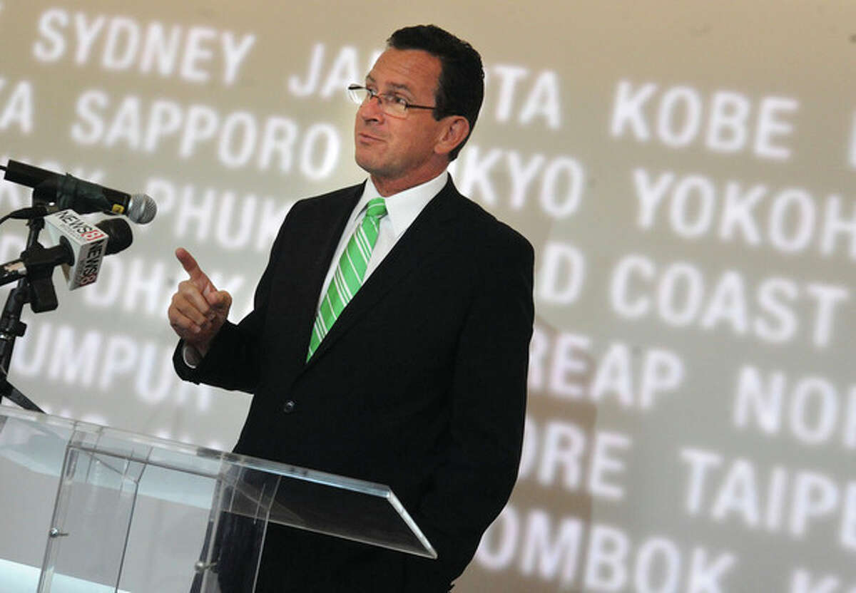Governor Dan Malloy speaks at the new Starwood Hotel at Corporate Headquartets in Stamford on Tuesday. photo/Matthew Vinci