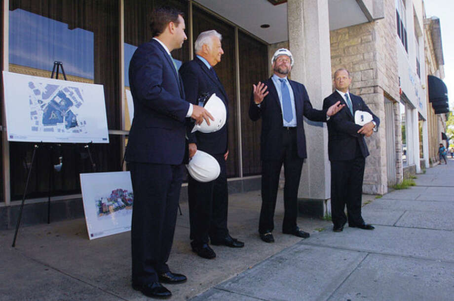 Hour photo / Erik Trautmann From left, State Sen. Bob Duff, D-25, Mayor Richard A. Moccia and Emil Albanese, chairman of the Norwalk Redevelopment Agency, listen as POKO CEO Ken Olsen speaks during a ceremonial groundbreaking on Wall St. Friday. / (C)2011, The Hour Newspapers, all rights reserved