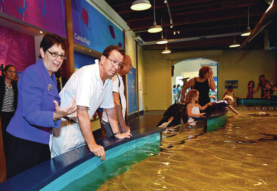 Hour photos / Erik Trautmann Gov. Dannel Malloy tours the Maritime Aquarium with aquarium President and CEO Jennifer Herring as part of the his summer-long effort to highlight the role that Connecticut's hospitality, tourism and recreation attractions play in strengthening the state's overall economy. / ©2012 The Hour Newspapers