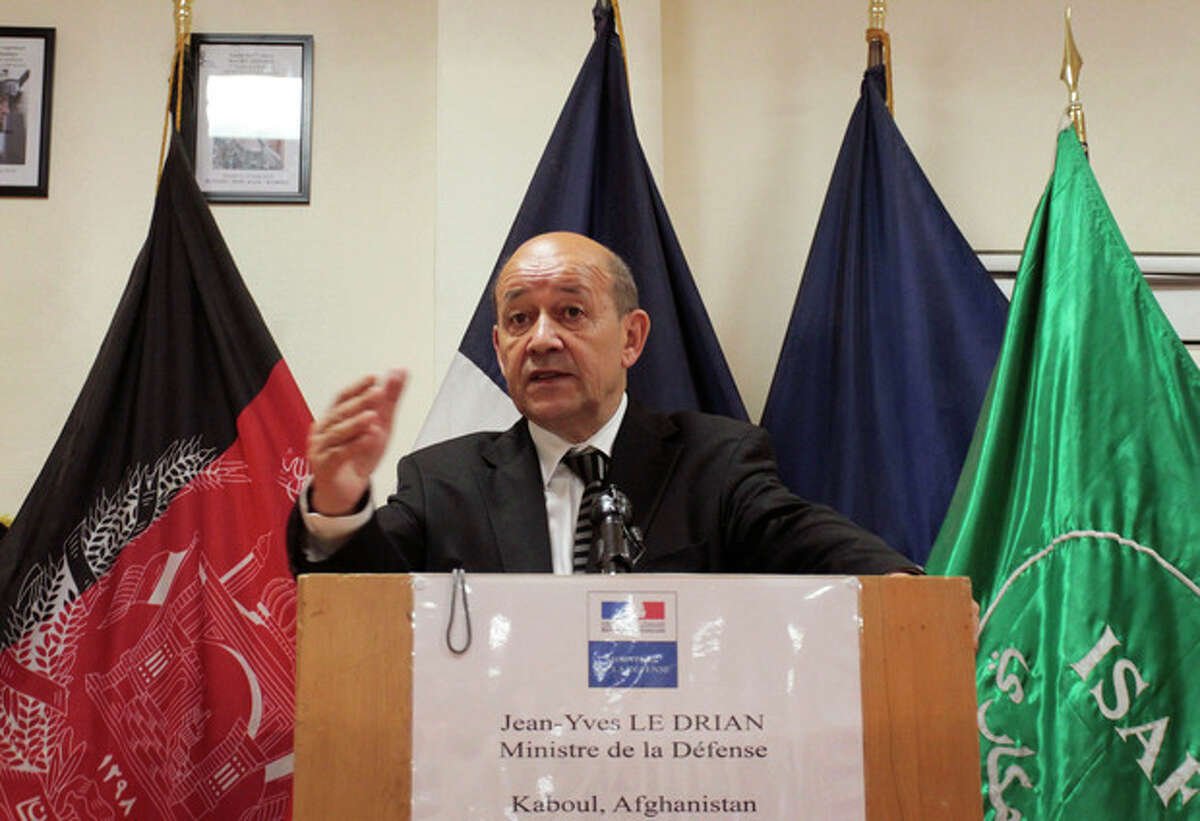 French Defense Minister Jean-Yves Le Drian speaks during a press conference in Kabul, Afghanistan, Wednesday, July 18, 2012. France's defense minister says that while Paris opposes capital punishment it will respect an Afghan military court's decision to sentence an Afghan soldier to death for killing four French troops. (AP Photo/Musadeq Sadeq)