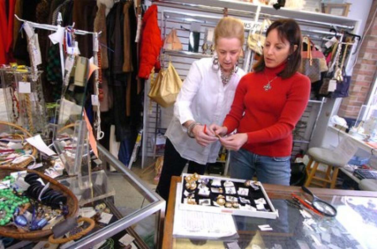 Photo/Alex von Kleydorff. Volunteers Janine Brown and Dottie DeLuca price some of the consigned and donated items at The Turnover shop in Wilton Center.