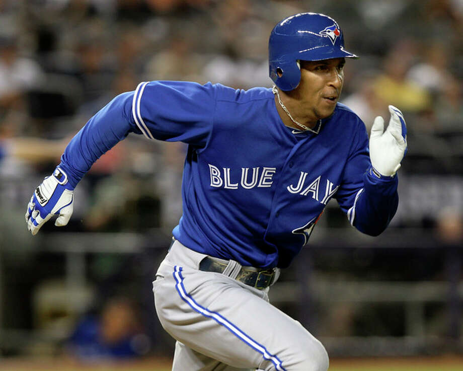 Toronto Blue Jays' Anthony Gose tries to reach first base after his first major league at-bat during the seventh inning of a baseball game against the New York Yankees, Tuesday, July 17, 2012, at Yankee Stadium in New York. (AP Photo/Seth Wenig) / AP