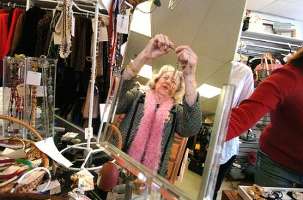 Photo/Alex von Kleydorff. Volunteer Sylvia Duffy works at organizing neclaces at The Turnover Shop in Wilton Center.