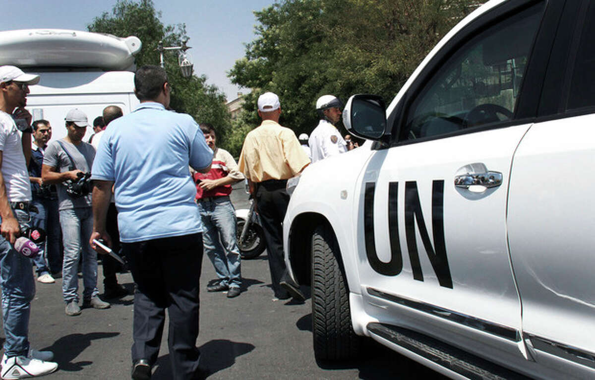 A UN observers vehicle arrives at the site where a suicide attack hit the National Security building in Damascus, Syria site in Damascus, Syria, Thursday, July 5, 2012. Syria's state-run TV said Wednesday that President Bashar Assad's brother-in-law was among the dead in a suicide bombing at the National Security building during a meeting of Cabinet ministers and senior security officials in Damascus. (AP Photo/Bassem Tellawi)