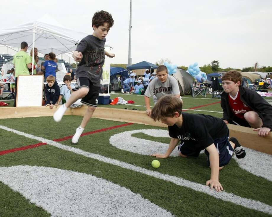 Jack Walsh, 13, plays a game called Gaga with friends during Relay for Life on the Wilton High School Track Field Friday evening. Hour Photo / Danielle Robinson