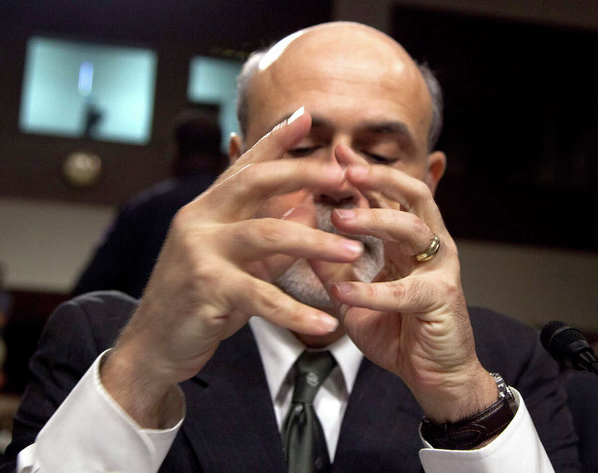 Federal Reserve Board Chairman Ben Bernanke moves to fold his hands as he prepares to give a semiannual report to the Senate Banking Committee, Tuesday, July 17, 2012, on Capitol Hill in Washington. Bernanke's testimony comes as job growth has slumped, manufacturing has weakened and consumers have grown more cautious about spending (AP Photo/Carolyn Kaster)