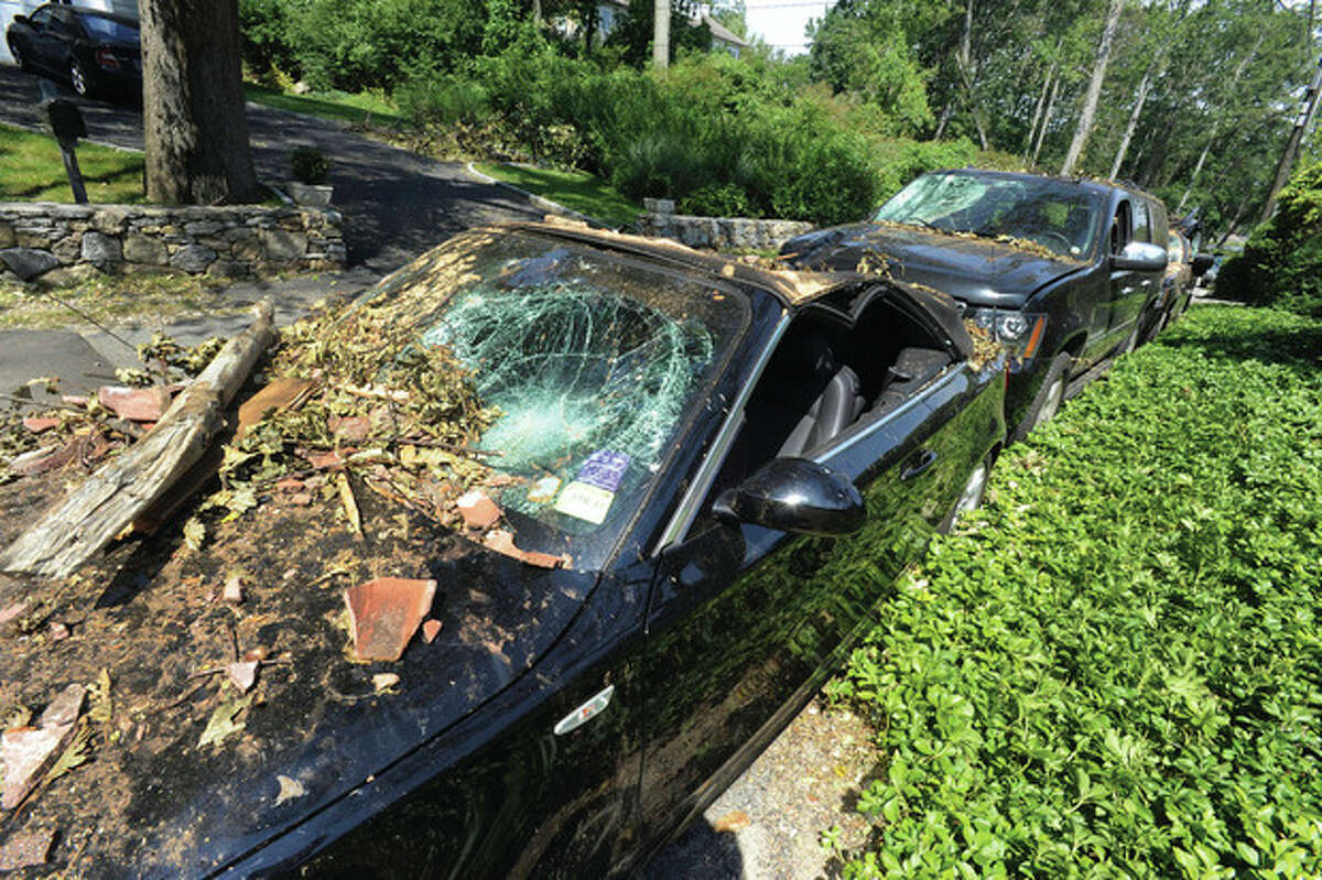 Hour photo / Matthew Vinci Damaged cars at Wilson Point in Norwalk on Thursday where FEMA was touring the area.