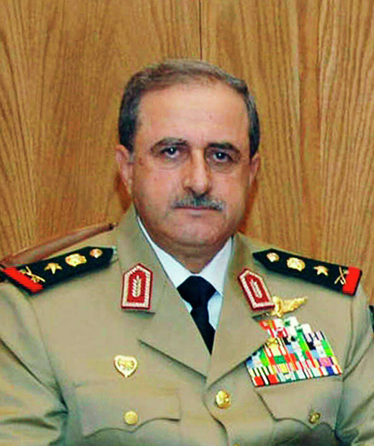 This undated photo released by the Syrian official news agency SANA, shows Syrian Defense Minister Gen. Dawoud Rajha in Damascus, Syria. Syria's state-run TV says the country's defense minister has been killed in a suicide blast in the capital. Wednesday's attack struck the National Security building in Damascus during a meeting of Cabinet ministers and senior security officials. (AP Photo/SANA) / SANA