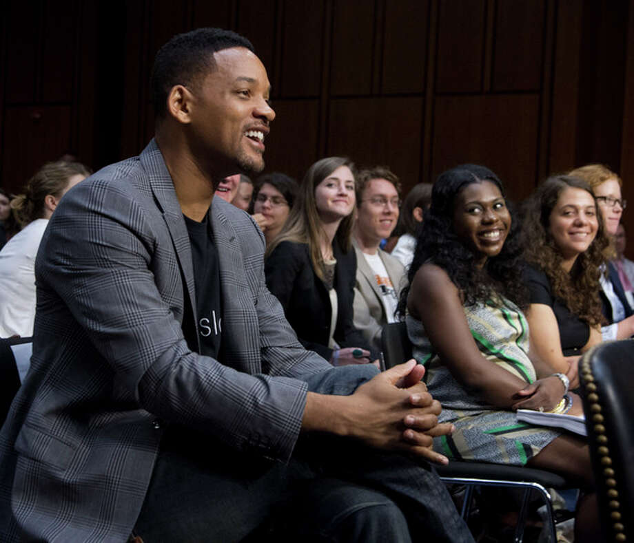 "Actor Will Smith, accompanying his wife Jada Pinkett Smith, not in picture, smiles as he is acknowledged in the hearing room by committee Chairman Sen. John Kerry, D-Mass., during a Senate Foreign Relations Committee on ""The Next Ten Years in the Fight Against Human Trafficking: Attacking the Problem with the Right Tools"" on Capitol Hill in Washington Tuesday, July 17, 2012. (AP Photo/Manuel Balce Ceneta) / AP"