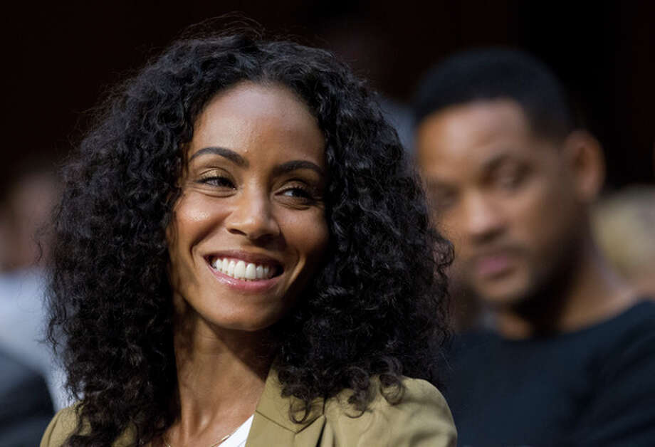 "Jada Pinkett Smith, accompanied by her actor husband Will Smith, testifies before the Senate Foreign Relations Committee during a hearing on ""The Next Ten Years in the Fight Against Human Trafficking: Attacking the Problem with the Right Tools"" on Capitol Hill in Washington Tuesday, July 17, 2012. (AP Photo/Manuel Balce Ceneta) / AP"