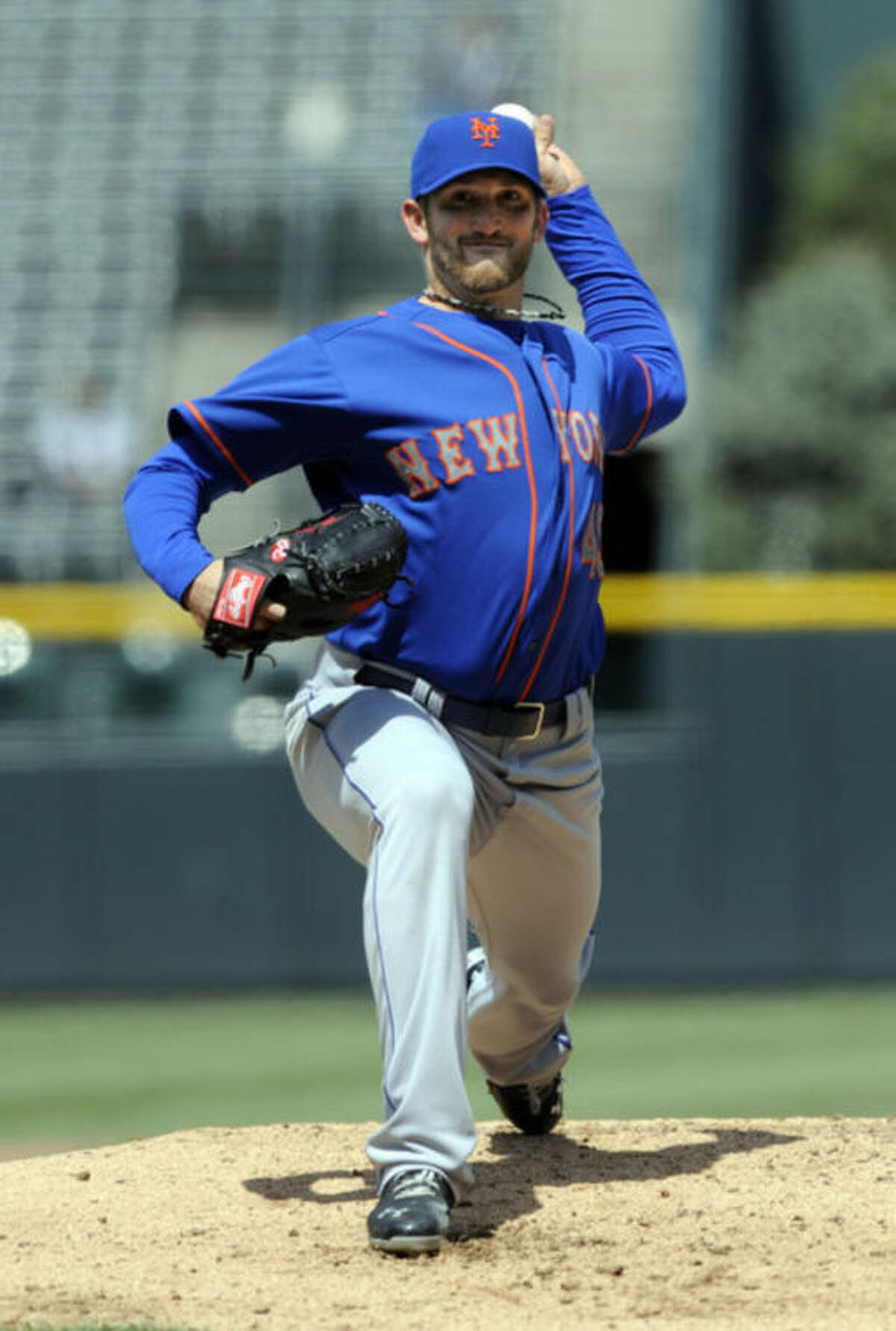 New York Mets starting pitcher Jonathon Niese throws to the plate against the Colorado Rockies during the first inning of a baseball game on Thursday, April 18, 2013, in Denver. (AP Photo/Jack Dempsey)