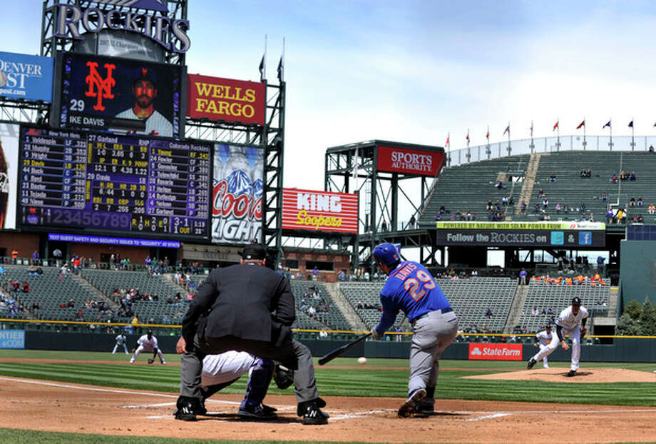 CORRECTS TO GROUNDS OUT, NOT CONNECTS FOR A SINGLE - New York Mets first baseman Ike Davis (29) grounds out against the Colorado Rockies during the first inning of a baseball game on Thursday, April 18, 2013, in Denver. (AP Photo/Jack Dempsey) / FR42408 AP