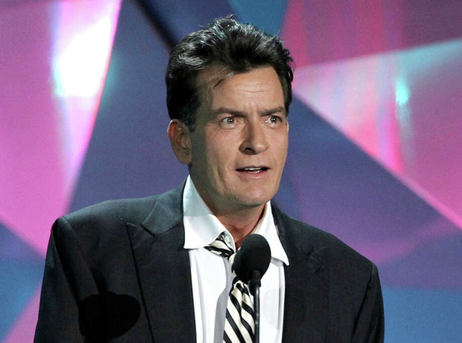 "FILE - This June 3, 2012 file photo shows actor Charlie Sheen at the MTV Movie Awards in Los Angeles. In an interview Tuesday, July 17, on Ryan Seacrest's radio show, Sheen said ""American Idol"" producer Nigel Lythgoe publicly threw his name out there as a possible judge and the idea peaked his interest. Sheen told Jay Leno Monday night on ""The Tonight Show"" that his two demands would be that FX and his ""Anger Management"" team ""would have to be into it"" and there would need to be a charitable component to him taking the job. (Photo by Matt Sayles/Invision/AP, file) / Invision"