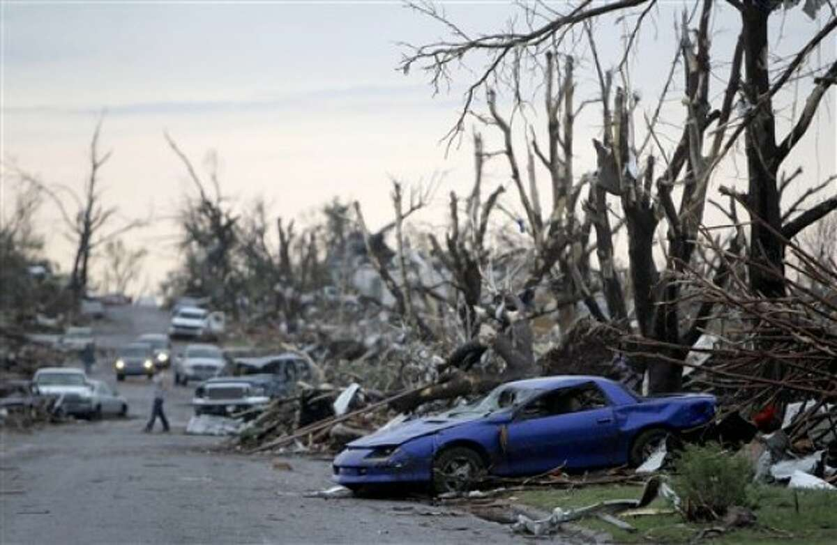 Tornado damage is seen Monday, May 23, 2011, in Joplin, Mo. A large tornado moved through much of the city Sunday, damaging a hospital and hundreds of homes and businesses and killing at least 89 people. (AP Photo/Jeff Roberson)