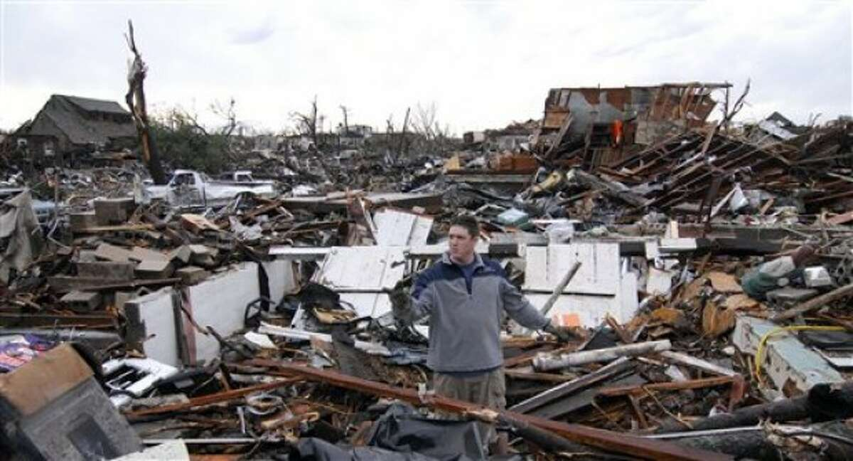 Aaron Hailey stands in what''s left of his home in Joplin, Mo, on Monday, May 23, 2011. Hailey was attempting to salvage items from his home that was leveled by a tornado that struck Joplin on Sunday, May 22. (AP Photo/Mike Gullett)